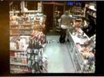 Suspect Sought in Liquor Store Robbery